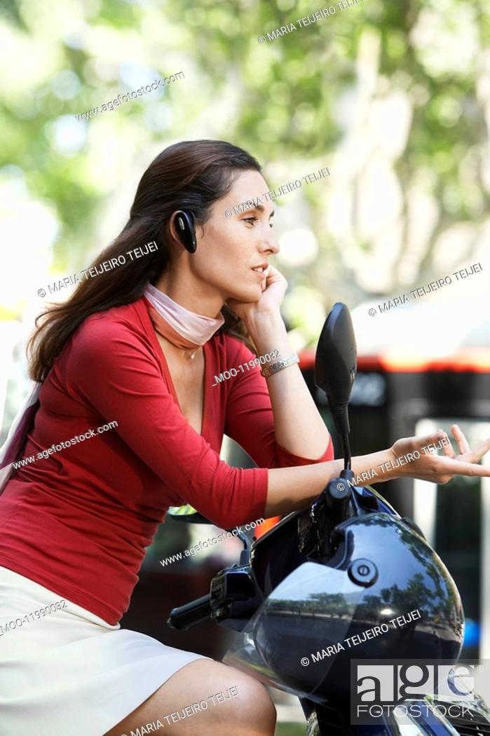 Stock Photo: Businesswoman Using Cell Phone on Moped.