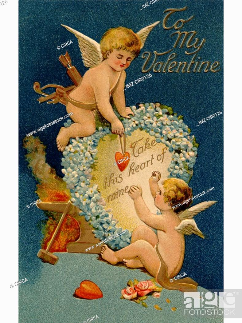 Stock Photo: A vintage Valentines card with two cupids and a heart.