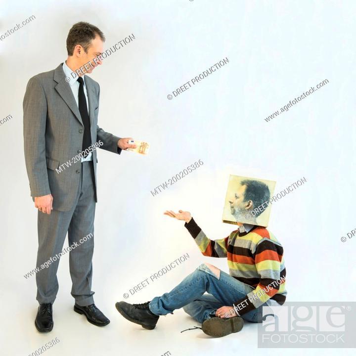 Imagen: Businessman imagining self image of beggar.