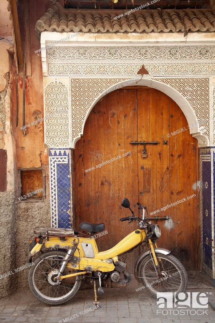 Stock Photo: Bike in Front of Arched Door in the Medina, Marrakech.