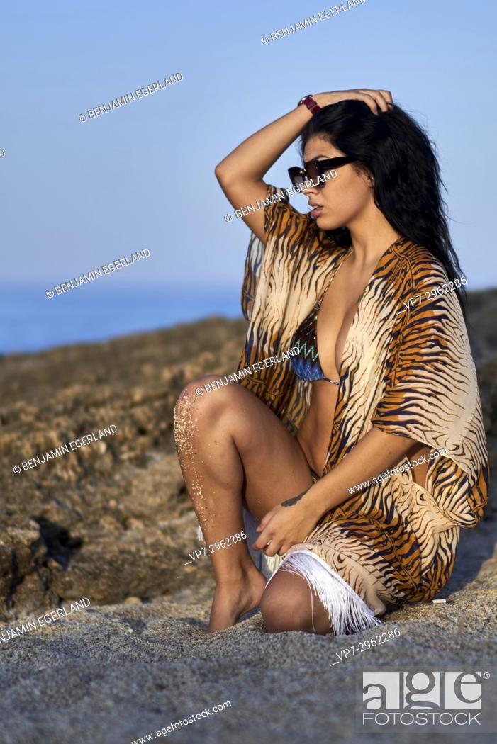 Photo de stock: sensual woman relaxing at Mediterranean beach. Greek ethnicity. 20 years old. In holiday destination Hersonissos, Crete, Greece.