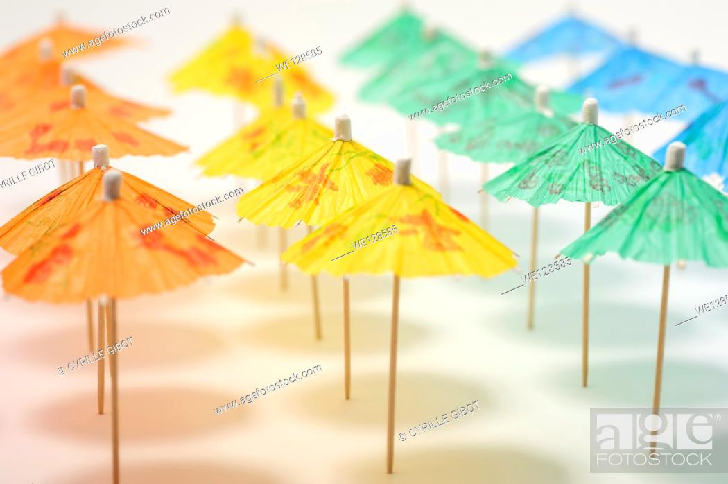Stock Photo: Row of umbrellas on beach.
