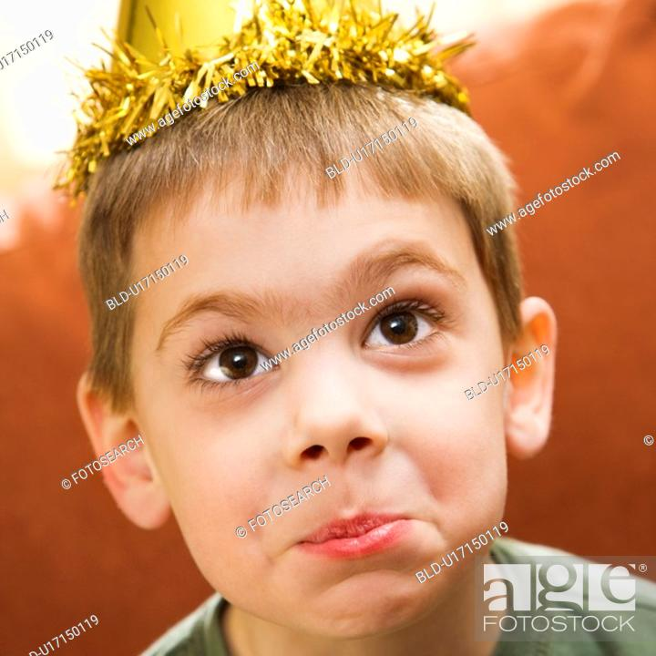 Stock Photo: Boy wearing party hat.
