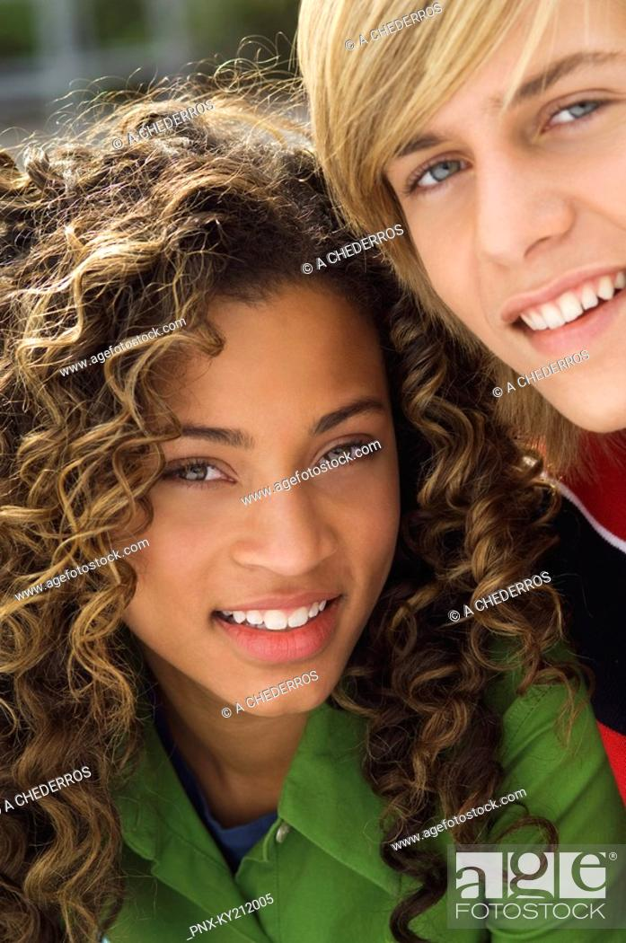 Stock Photo: Portrait of a teenage boy smiling with a girl.