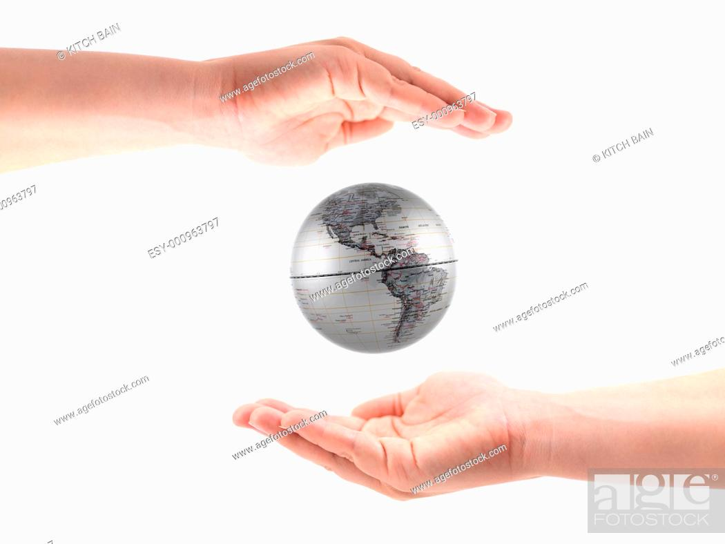 Stock Photo: A female hand with coin isolated against a white background.