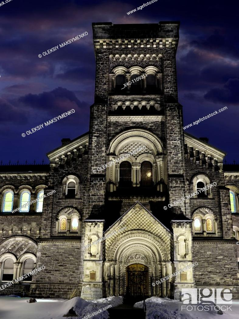 Stock Photo: University College building at night at University of Toronto Canada Victorian architecture Artistic wintertime scenery with dramatic sky.