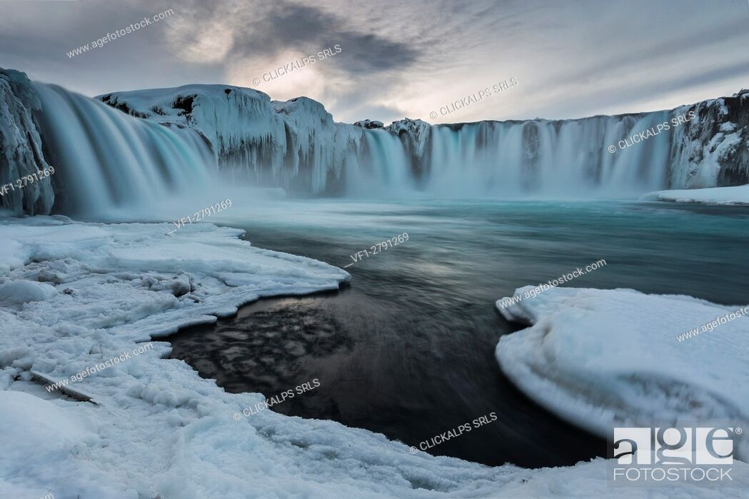 Photo de stock: Gullfoss waterfall in norther Iceland near Akureyri after the sunset, during the blue hour in a cold winter evening.