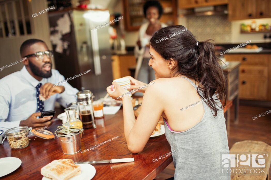 Stock Photo: Couple drinking coffee and eating breakfast at table.