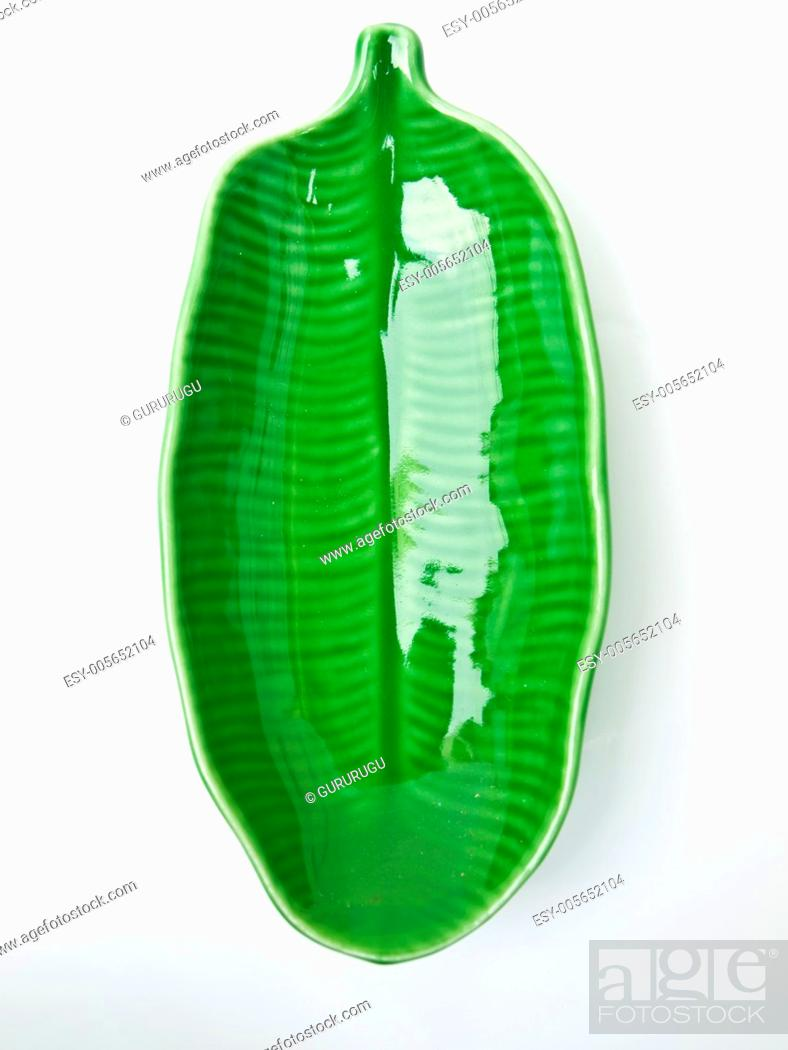 Stock Photo: A green banana leaf ceramic dish isolated on white background.