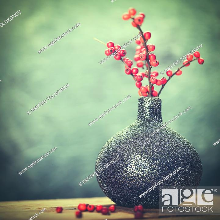 Stock Photo: Abstract still life with ceramic vase and red berries.
