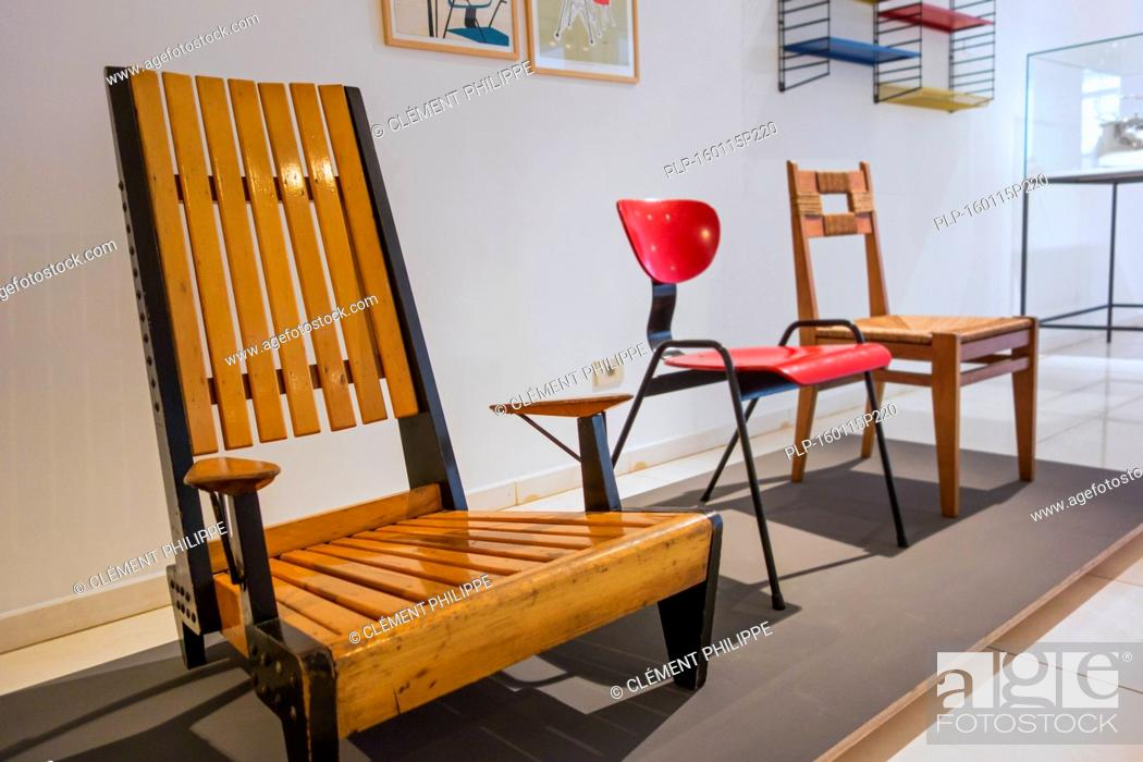 Stock Photo: Contemporary Wooden Chairs And Furniture Of The Fifties In The  Design Museum Gent