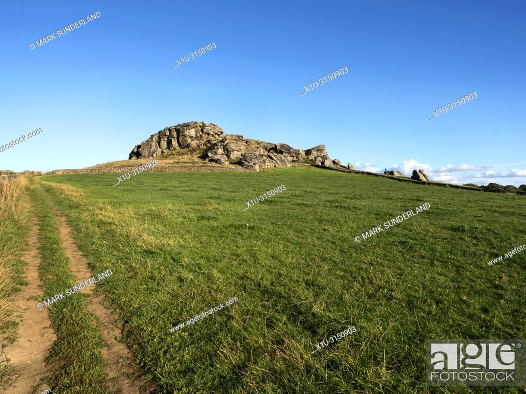 Stock Photo: Almscliff Crag millstone grit outcrop near Harrogate North Yorkshire England.