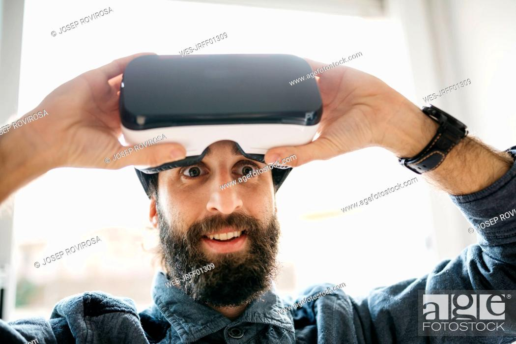 Stock Photo: Portrait of starring man with Virtual Reality Glasses.