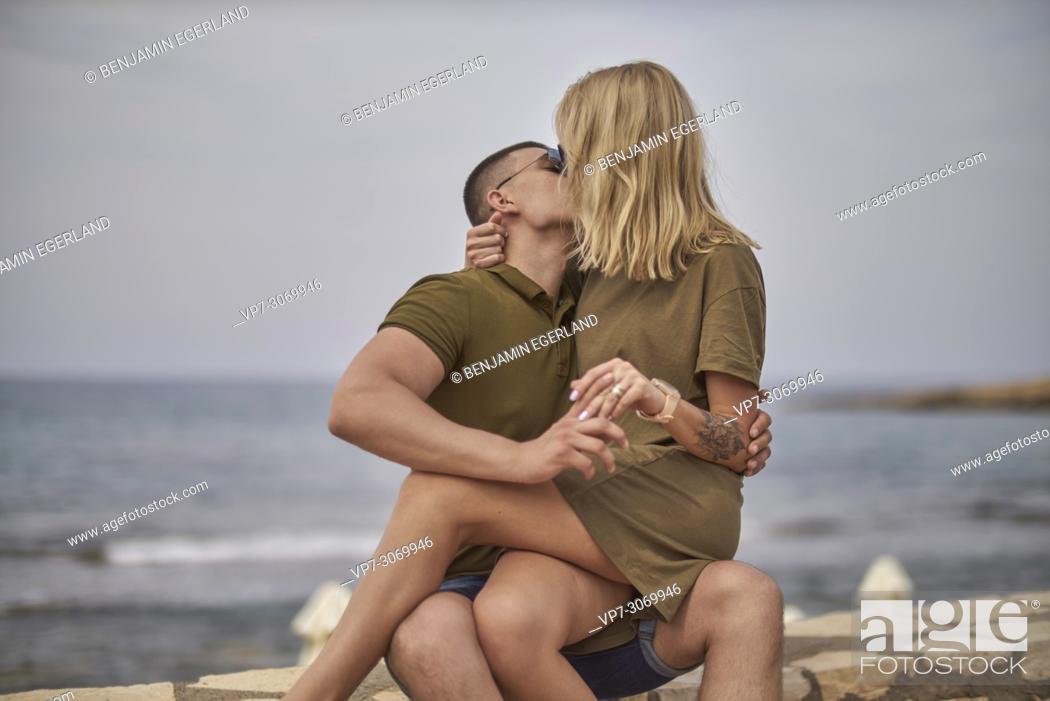 Stock Photo: Young couple kissing, Russian ethnicity, Hersonissos, Crete, Greece.