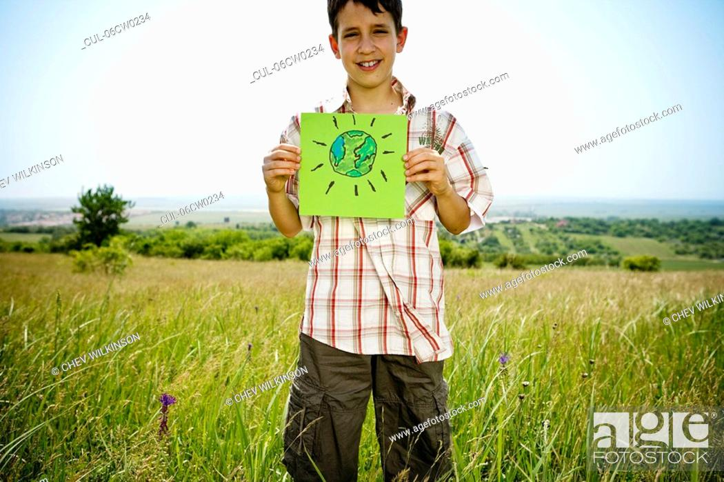 Stock Photo: Boy holding picture of earth.
