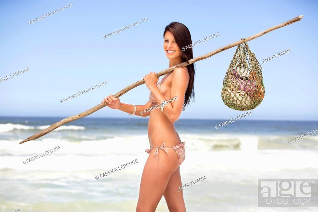 Stock Photo: Young woman carrying net bag on shoulder.