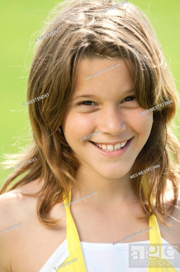 Stock Photo: Girl 10-11 smiling, portrait, close-up.