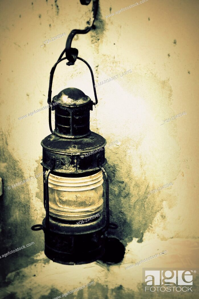 Stock Photo: Front view of a rusty oil lantern.