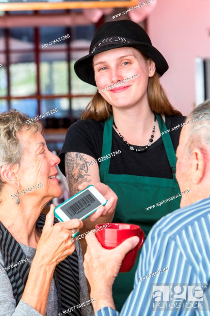 Stock Photo: Customer giving barista her phone with barcode coupon on it.