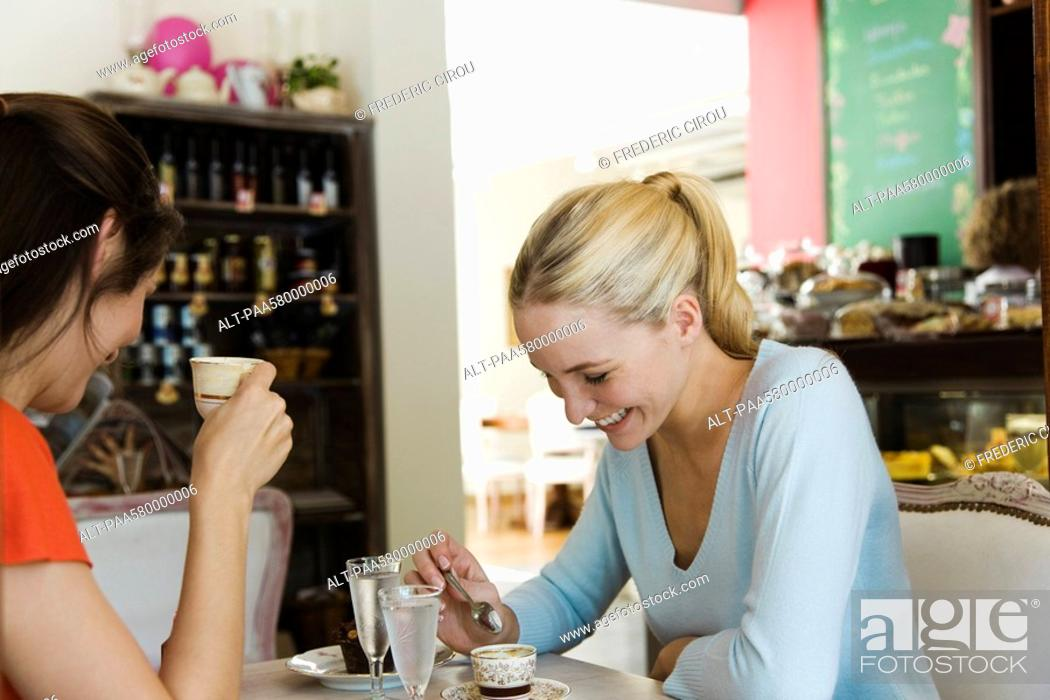 Stock Photo: Female friends having coffee in cafe.