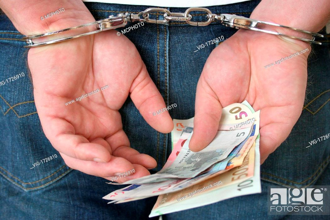 Stock Photo: man in handcuffs - 01/01/2009.