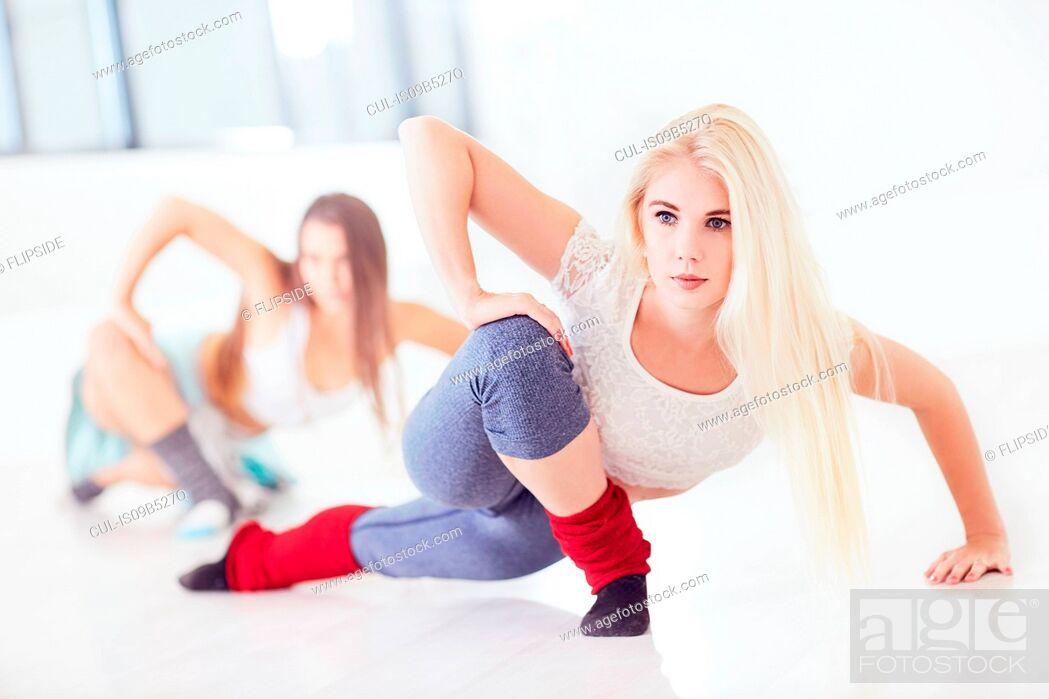 Stock Photo: Two female ballet dancers practicing in dance studio.