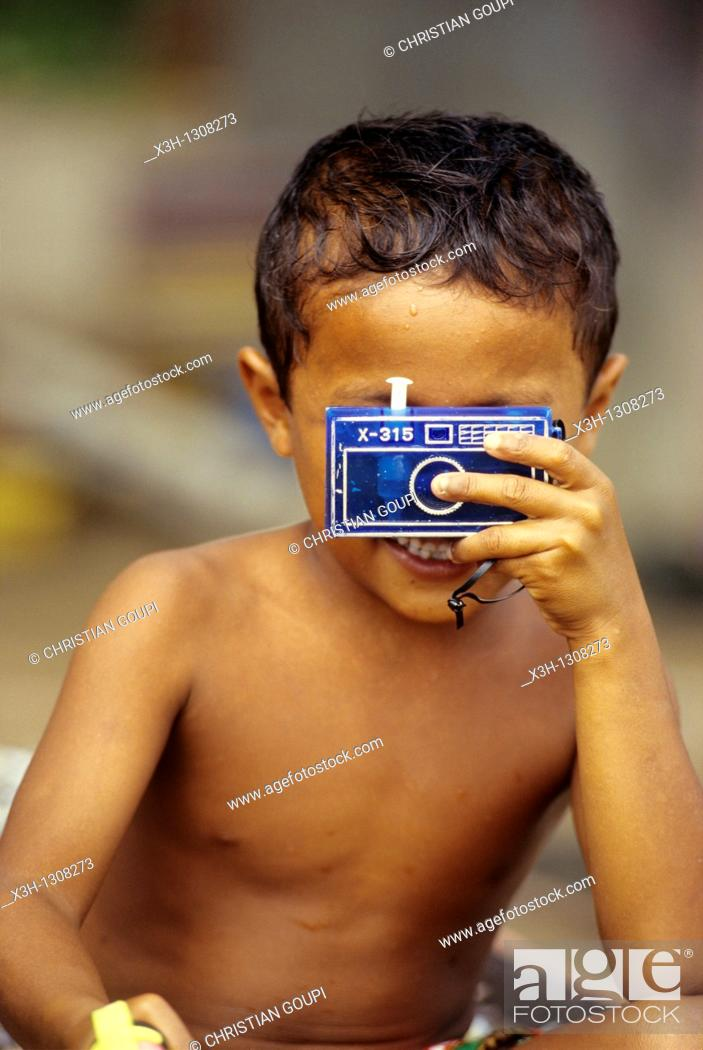 Stock Photo: little boy with a facticious camera, Sumatra island, Republic of Indonesia, Southeast Asia and Oceania.