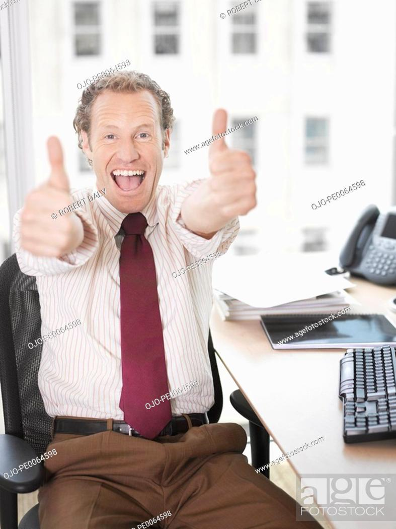 Stock Photo: Businessman giving thumbs up.