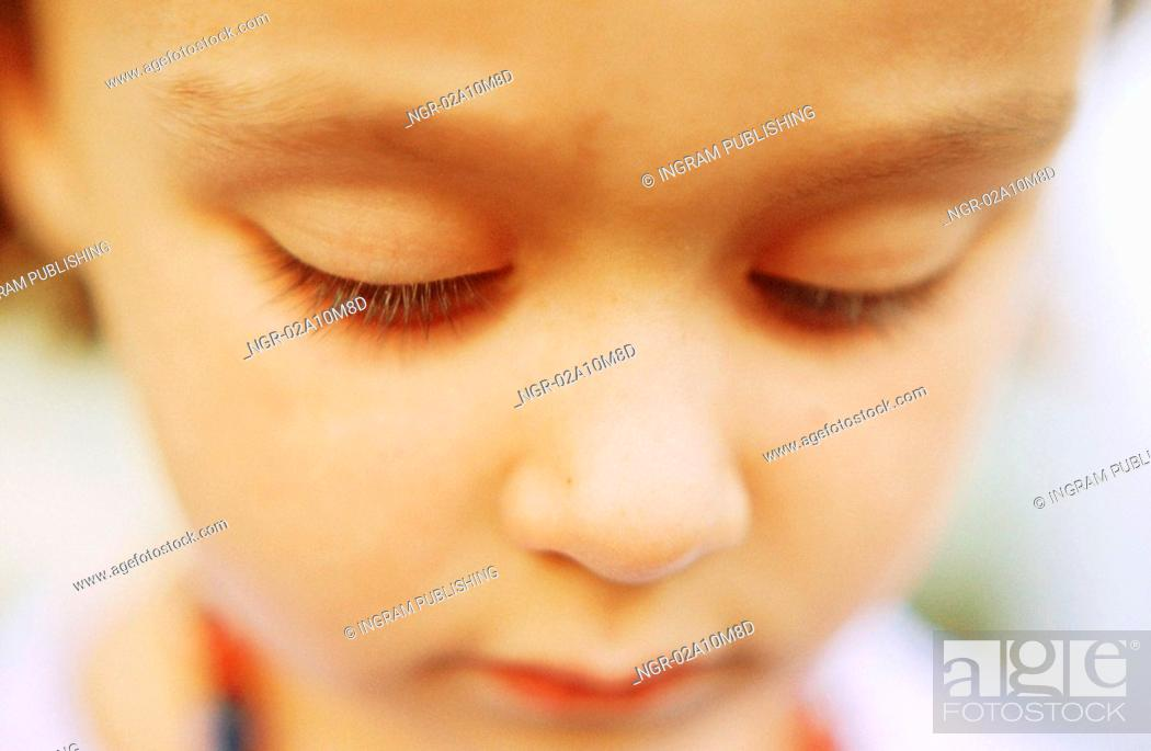 Stock Photo: Child Looking Down.