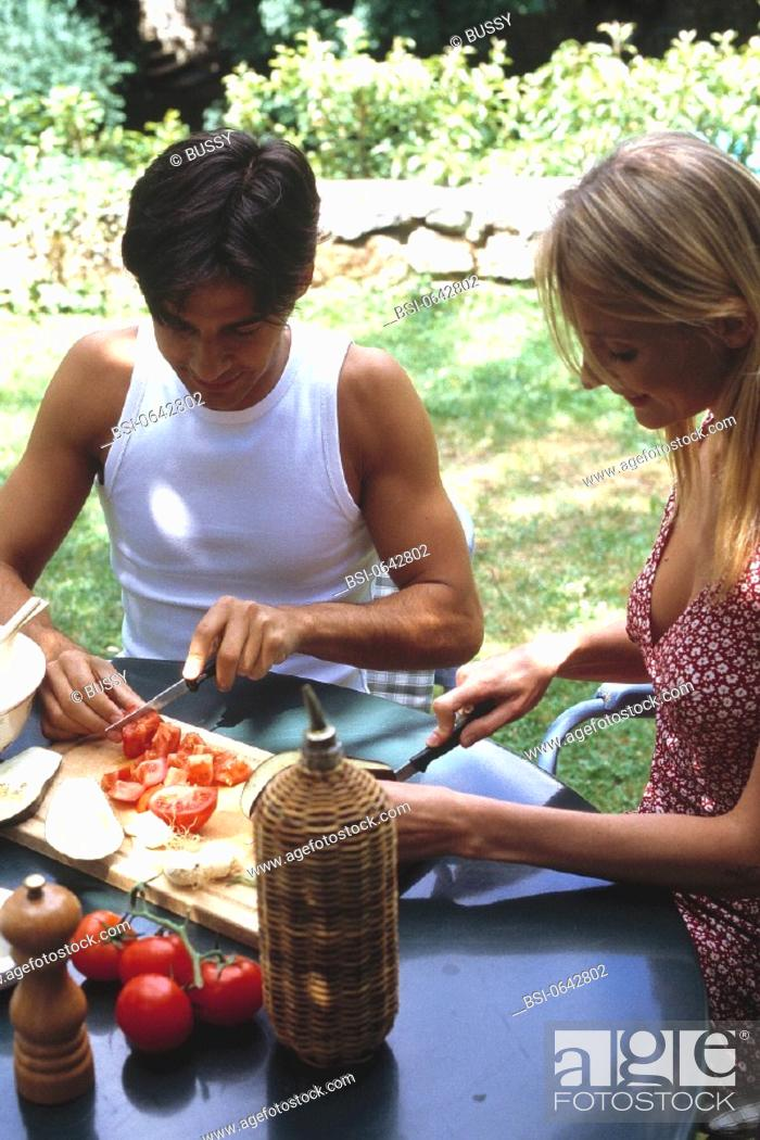 Stock Photo: COUPLE EATING RAW VEGETABLES<BR>Models. Model release for restricted use. Please inquire for details.