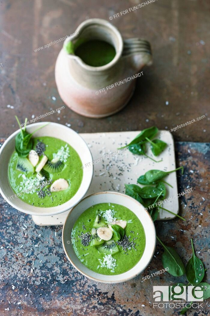 Photo de stock: Green 'boost' smoothie bowls with shaved coconut.