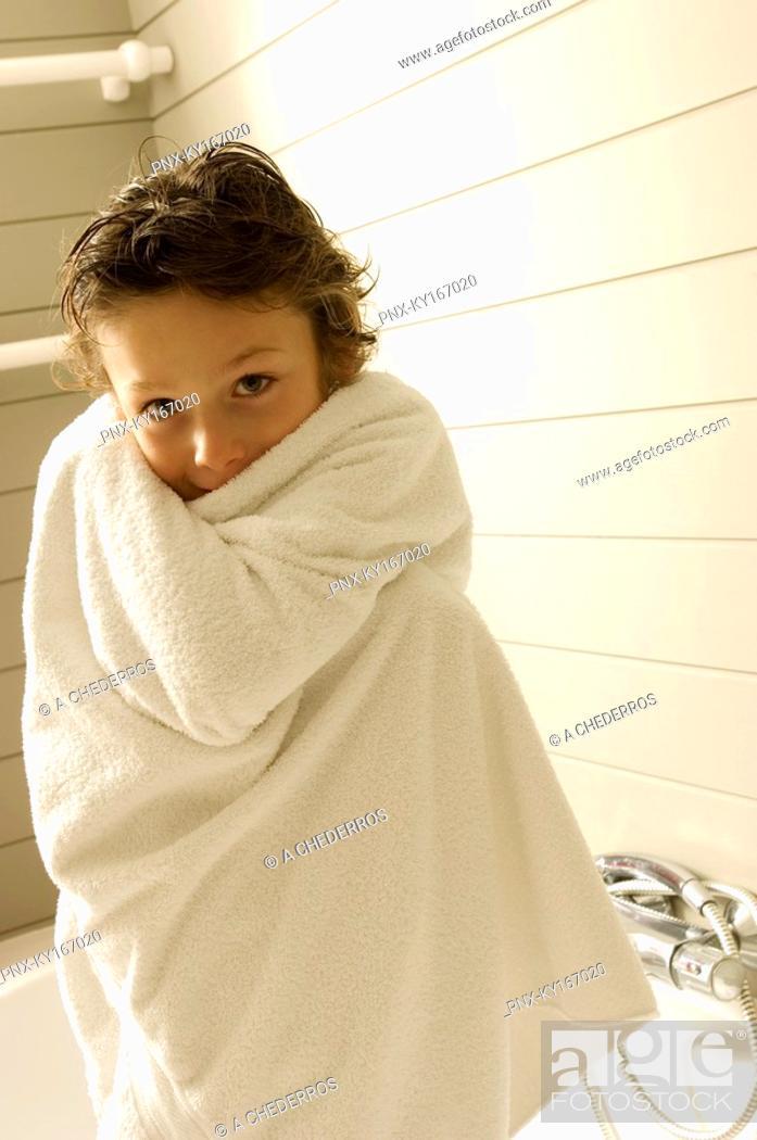 Photo de stock: Portrait of a boy wrapped in a towel.