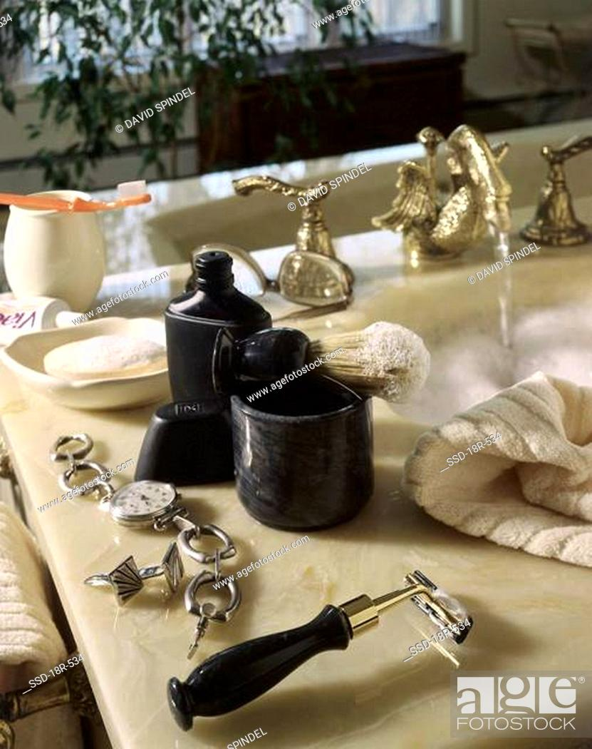 Stock Photo: Close-up of grooming products on a sink.