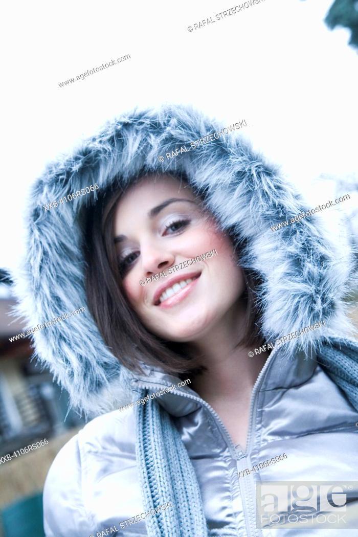 Stock Photo: portrait of a woman in winter jacket.