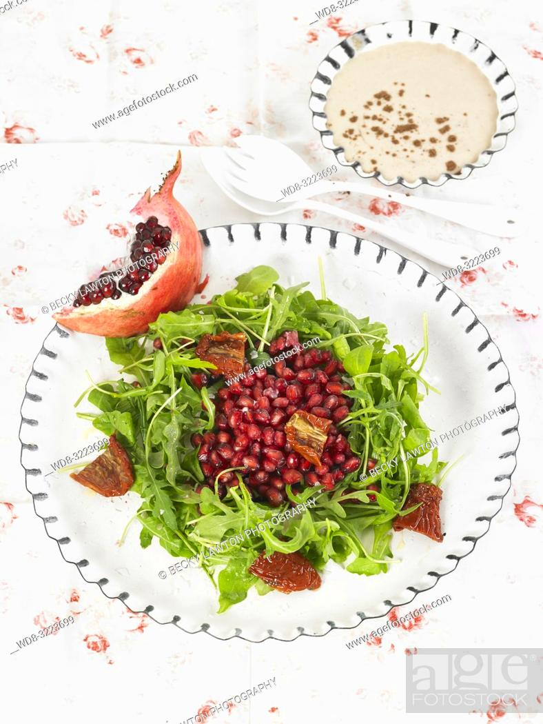 Stock Photo: ensalada de granada con chocolate y tomates con bol de salsa tahini / Pomegranate salad with chocolate and tomatoes with bowl of tahini sauce.