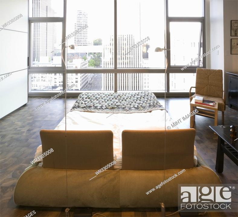 Stock Photo: Modern bedroom in luxury highrise apartment.
