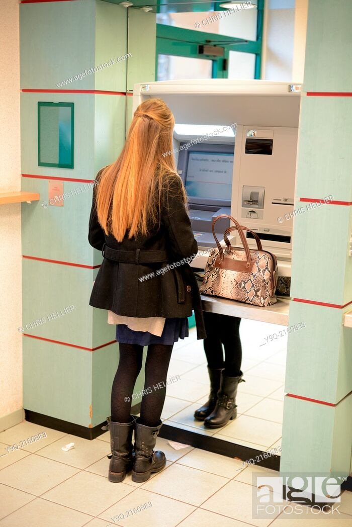 Stock Photo: Student Withdrawing Money from BTM Machine in Bank Aix-en-Provence France.