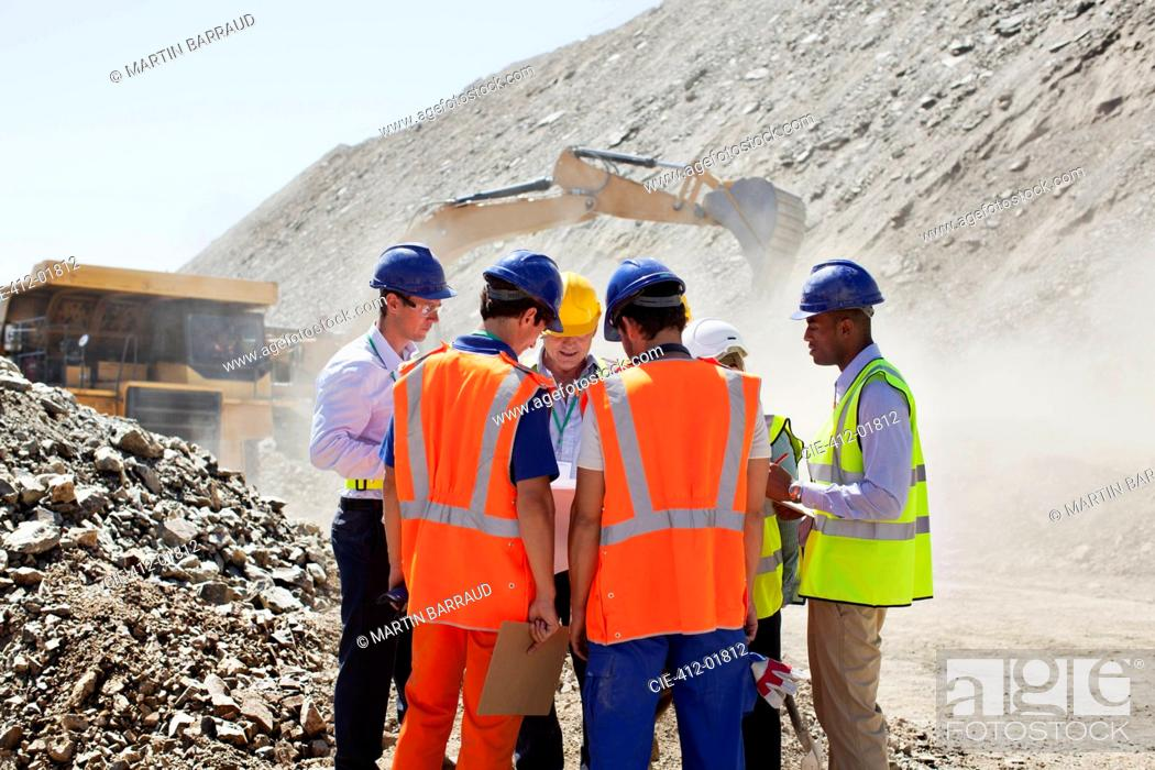 Stock Photo: Workers talking in quarry.