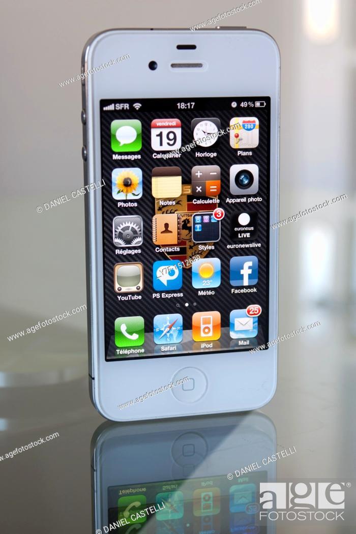 Stock Photo: White Apple phone iphone 4 on desk.