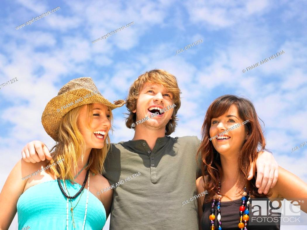 Photo de stock: Portrait of three young people.