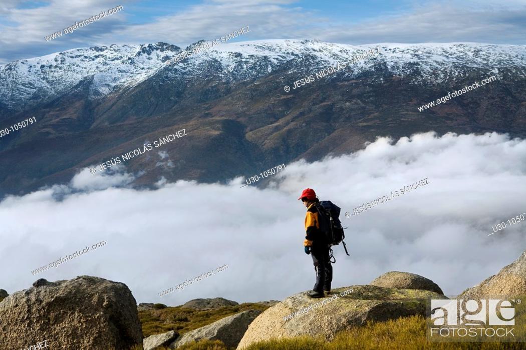 Stock Photo: Mountaineer looking Jerte Valley from Sierra de Barco  Mountains of Sierra de Gredos National Park  Ávila  Castilla y León  Spain.