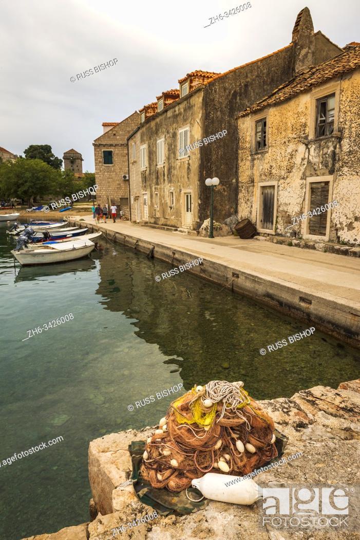 Stock Photo: Fishing boats and nets in Sudurad, Sipan Island, Dalmatian Coast, Croatia.