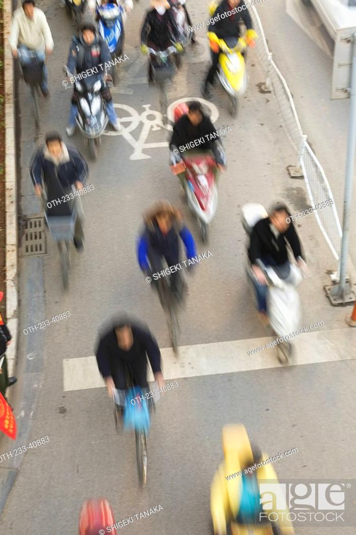 Stock Photo: Pedestrian traffic in the city of Kunming, Yunnan Province, China.