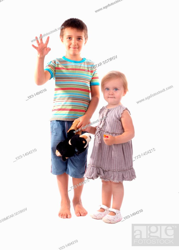 Stock Photo: Brother and little sister isolated on white.