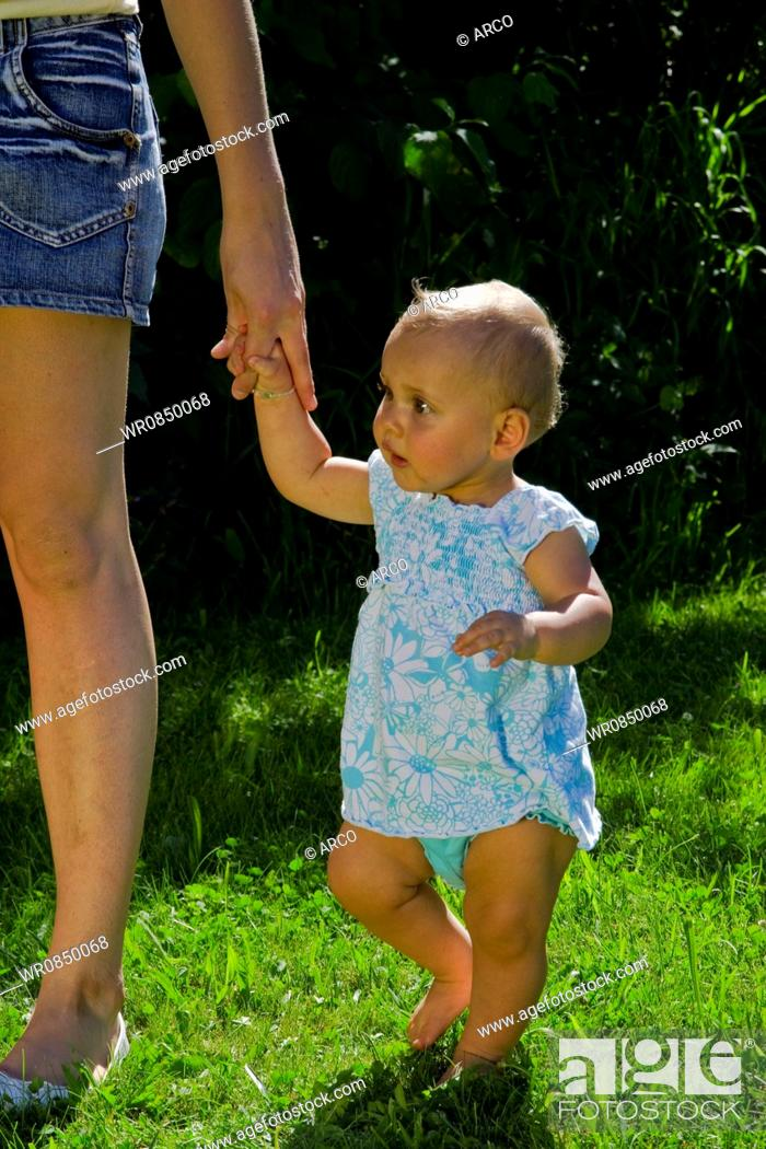 Stock Photo: Baby at mother's hand, mother and daughter / lawn.
