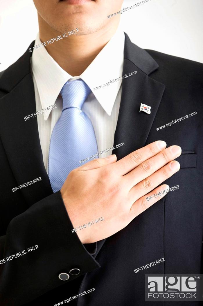Stock Photo: businessman saluting.