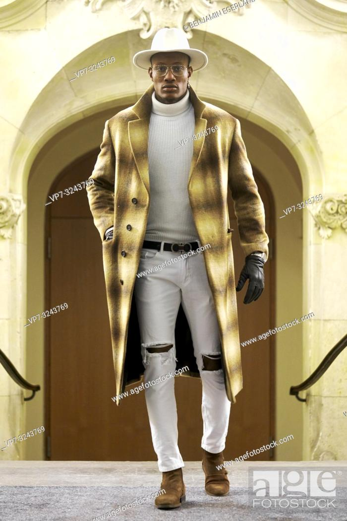 Stock Photo: stylish wealthy man wearing expensive winter coat and fashionable men's outfit, success, in Munich, Germany.