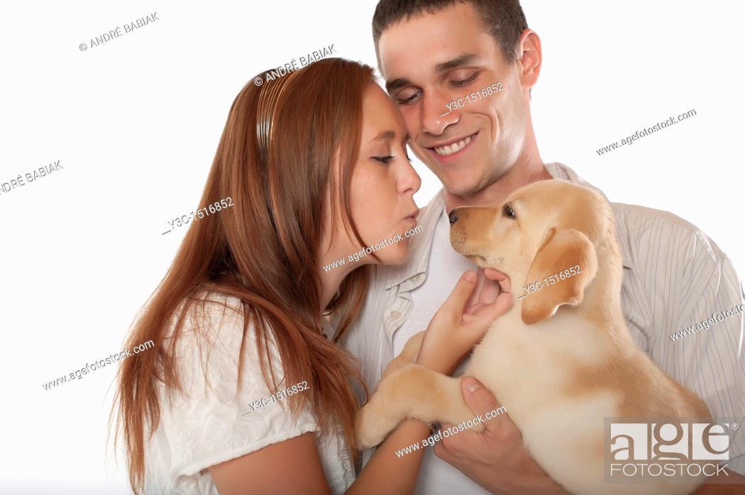Stock Photo: Young couple with labrador retriever puppy.