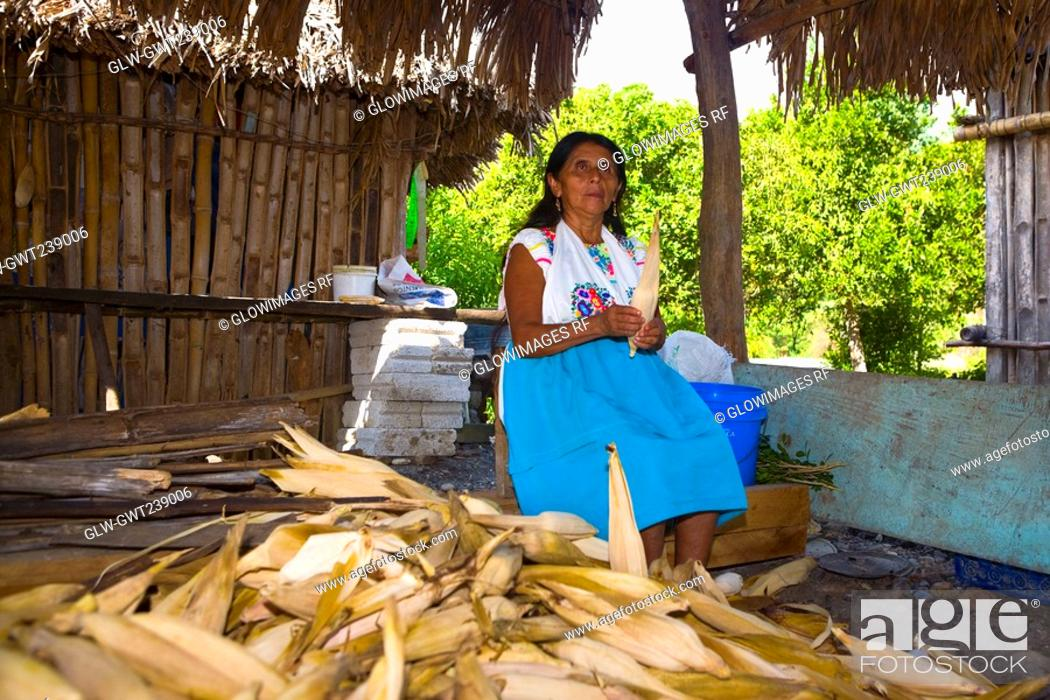 Stock Photo: Mature woman peeling corn, Papantla, Veracruz, Mexico.