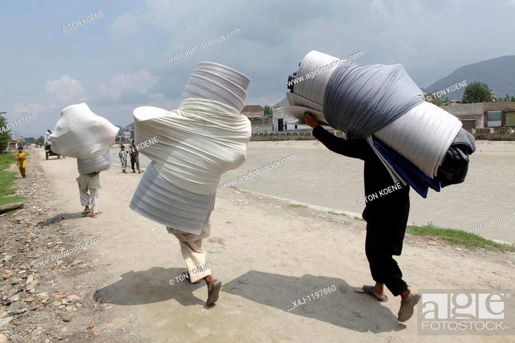 Stock Photo: charity distribution to flood victims in pakistan.